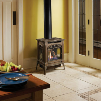 Lopi brand traditional black gas stove in a home Spa Brokers