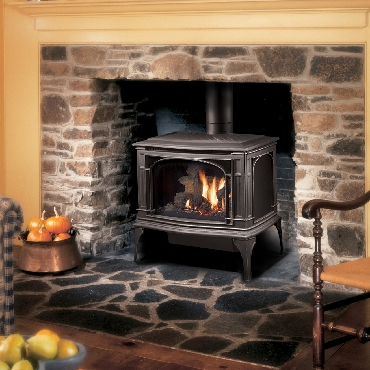 traditional black gas stove Lopi in a fire place Spa Brokers
