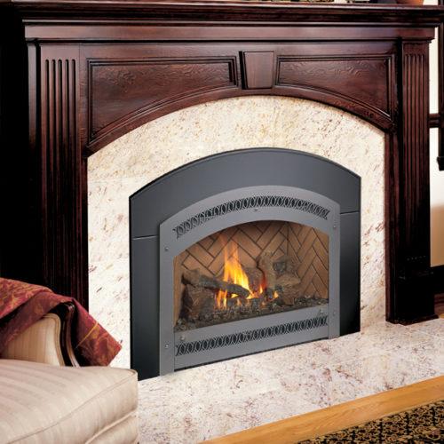 black xtrordinair 34DVL fireplace insert around traditional wood fireplace Spa Brokers