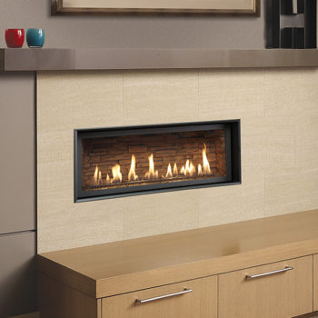 contemporary xtrordinair 3516 gas fireplace insert surrounded by light stone Spa Brokers