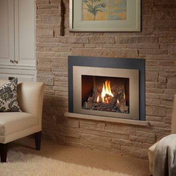 xtrordinair 430 black and copper fireplace insert surrounded by traditional brick fireplace Spa Brokers