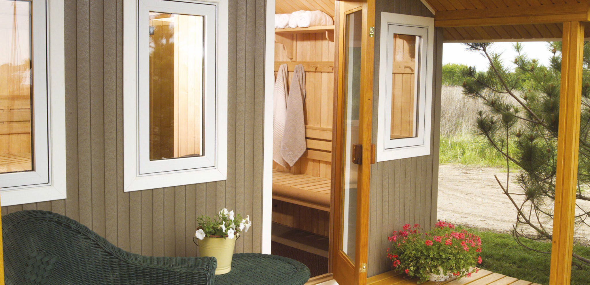 Saunatec Finnelo Metro Outdoor Sauna outside home on patio with windows spa brokers