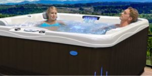 man and woman relaxing in outdoor hot tub Spa Brokers Denver